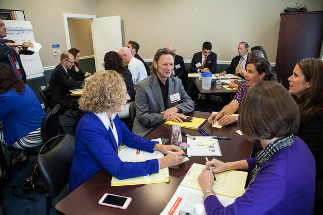 Participants brainstorm novel ways of using technology to increase access to English language learning.