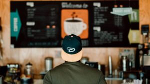 man ordering at coffee shop
