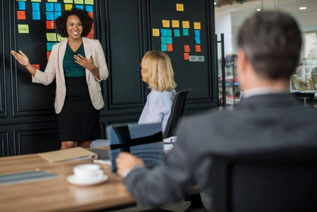 woman giving boardroom presentation